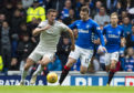 Aberdeen's Dominic Ball (L) in action with Rangers' Jon Flanagan