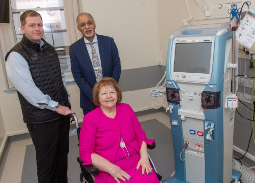Simon Cowie with Dr Izhar Khan, NHS Grampian consultant nephrologist and Hiezel Cowie next to one of the new machines.