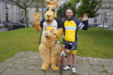 Steve Rae (right) with Kuddles the Befriend a Child mascot.