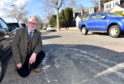 Worn out 20mph sign on Angusfield Avenue with Councillor John Cooke