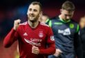 Aberdeen's Niall McGinn celebrates his sides win.