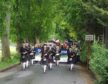 March to raise awareness of mental health issues was led by Northern Constabulary Community Pipe Band. credit Dave Conner