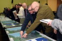 Residents assess the flood prevention plans in January