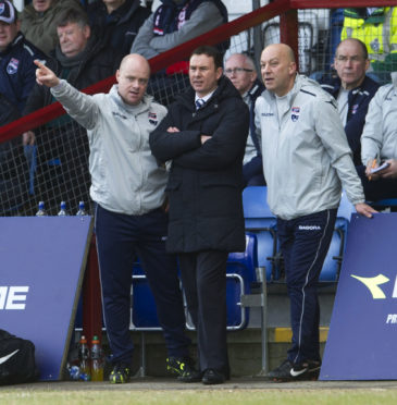 02/03/13 CLYDESDALE BANK PREMIER LEAGUE ROSS COUNTY V ICT (0-0) VICTORIA PARK - DINGWALL Ross County manager Derek Adams (centre) with assistant Neale Cooper (right) and coach Steven Ferguson.