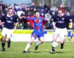 Steven Ferguson in action for Ross County against Caley Thistle.