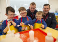 GENERATION SCIENCE Liberty STEM Amabassadors Ally Rowantree and James Rosie (right) oversee the 'fizzy' results of  P1/2 pupils (left - right) Logan Knox, Ollie Lamont and Alex Whiteford during the 'Generation Science' experiment at Caol Primary School. PICTURE IAIN FERGUSON, THE WRITE IMAGE