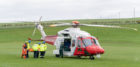 This is from the rescue of a party that fell and injured themselves within the Rotary Club of Buckie, Charity Event, 6 Harbours Walk, Scotland. It is understood that a participant fell and was unable to walk, whereby Coastguard Ground and Helicopter Teams were deployed to manage the casualty. The Casualty would have been placed into the Helicopter in the area of Crannoch Hill, Cullen and taken to Ambulance at Cullen Bay Holiday Park. The party was then taken to Dr Grays Hospital, Elgin. It is not thought that injury is Life Threatening. Photographed by JASPERIMAGE © - PICTURE CONTENT: - The Patients is removed from Rescue 151 from Inverness by Coastguard Teams from Buckie and conveyed on stretcher to aawaitin Ambulance