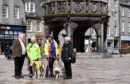 Dell Henrickson, Mary Rasmusen with her guide dog Vince, Ells McHaffie with her assistance dogs Alfie and Blossom, and Pamela Munro of Guide Dogs