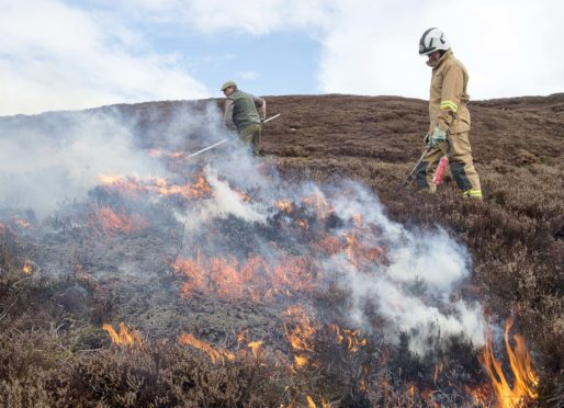 Head keeper Iain Hepburn and station officer Alex McKinley of the Scottish Fire Service carry out controlled burning on the Dunmaglass Estate