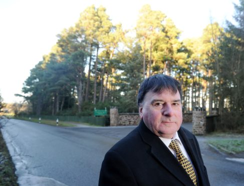 Highland Councillor Ken Gowans at the site of the proposed developments at Treetops Riding Centre in Balloch near Inverness and Culloden.