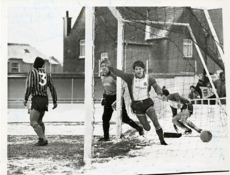 """Turning on the heat at Allan Park despite the wintry conditions is Cove Rangers Gary Leiper, who left Keith keeper Thain and his defence cold when he scored the home team's first goal."""" Picture taken 10 January 1987."""