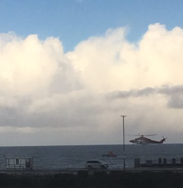 A picture of the Coastguard helicopter and RNLI lifeboat at Aberdeen beach this afternoon by Twitter user @YorkshireDeb45.