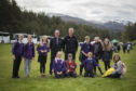 Bruce McKendrick, chief executive of Forest Holidays, and Grant Moir, chief executive of the CNPA, with pupils from Aviemore primary school yesterday at the Cairngorms Nature BIG Weekend