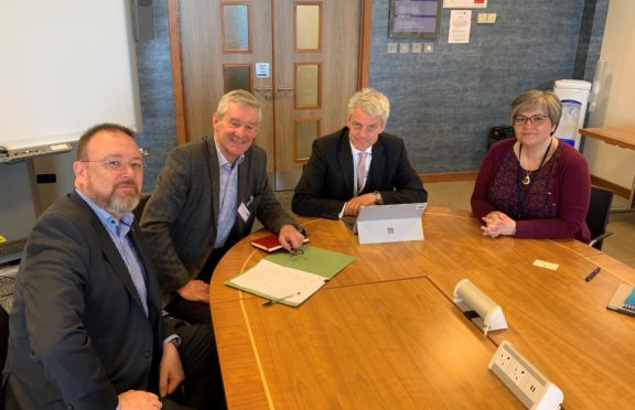 Left to right is MP David Duguid, MSP Peter Chapman, Aberdeenshire Health and Social Care Partnership chief officer Adam Coldwells and partnership manager Angie Wood having a meeting about the Minor Injury Unit Reviews