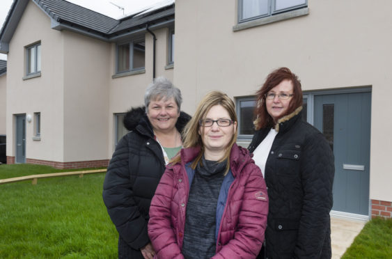 Communities Committee chairwoman Anne Stirling, Erroll Court resident Julie Killoh, and committee vice-chairwoman Cllr Iris Walker. The Turriff properties are existing affordable homes built by the council.