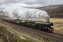 """Ex LNER A4 Pacific No.'60103 """"Flying Scotsman' and Ex LNER Thompson Class B1 No. 61306 'Mayflower' approaching Drumochter Summit, between Blair Atholl and Dalwhinnie, with the Steam Dreams Highlands and Islands tour on 10th May 2019. 'Loch Arkaig' is on the rear. Picture by Alastair Bellamy"""