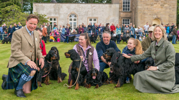 Angus and Zara Gordon Lennox with the assembly of Gordon Setters within their Castle Grounds.