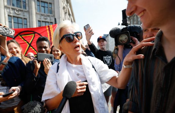 "British actress Emma Thompson speaks to media as she joins climate change activists occupying the road junction at Oxford Circus in central London on April 19, 2019 during the fifth day of an environmental protest by the Extinction Rebellion group. - Undeterred by over 400 arrests, climate change activists continued their demonstration into a fifth day in London with a small protest at the country's main Heathrow Airport, along with the ongoing protest camps at other iconic locations around the British capital.  Demonstrators began blocking off a bridge and major central road junctions on April 15 at the start of a civil disobedience campaign calling for governments to declare an ecological emergency over climate change, to reduce greenhouse gas emissions to zero by 2025, halt biodiversity loss and be led by new ""citizens' assemblies on climate and ecological justice"". (Photo by Tolga AKMEN / AFP)        (Photo credit should read TOLGA AKMEN/AFP/Getty Images)"