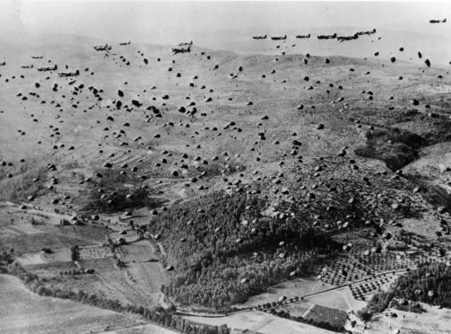 Parachutes fill the sky over the beachhead between Marseilles and Nice, during the Allied Invasion of France.