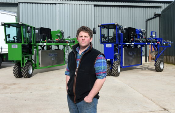 Gillan McDonald with two of the new sprayers.