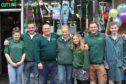 Kevin Milkins and his family outside the shop prior to its official opening in April 2010.