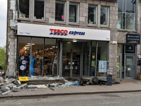 Van crashes into North Deeside Road shopfront | Press and Journal