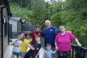 Morag and Gordon Reid and their five grandchildren