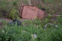 Pictures show rubbish at the park beside Archibald Grove/Douglas Crescent in Buckie. Pictures by Jason Hedges.