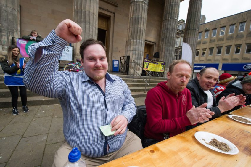Jamie Harbour steals the Haggis eating competition and is declared winner!
