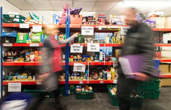 Volunteers at work in Moray Foodbank's stores in Elgin.