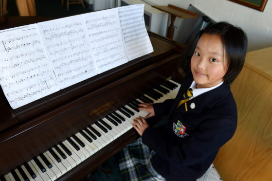 Pianist Sonia Zang, 12, was named Junior Burnsian of the Year.