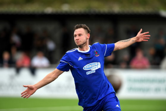 Cove's Mitch Megginson celebrating his second goal.      Picture by Kami Thomson