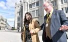Amanda Burt and Cllr John Cooke are helped across the road by Guide Cate Vallis.     Picture by Kami Thomson