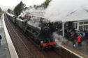 The Flying Scotsman arrives at Kingussie train station.   Picture by Sandy McCook