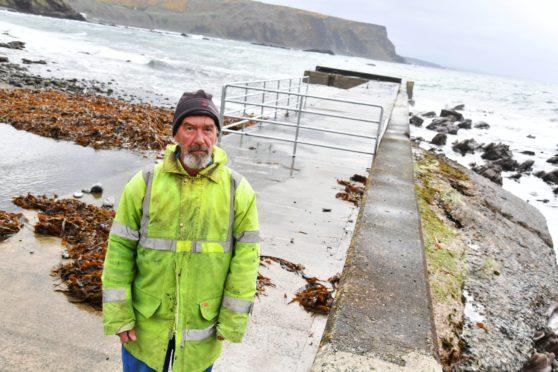 Crovie resident Bill Wiseman at the pier