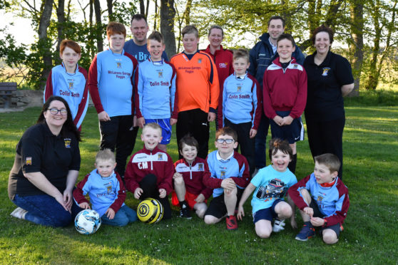 St Marnans sports club chairwoman Fiona Calder (l) with committee members and some of the youngsters who take part in the club's activities.