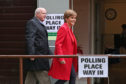 SNP leader Nicola Sturgeon and chief executive of the SNP Peter Murrell arrive at a polling station at Broomhouse Park Community Hall in Edinburgh to cast their votes for the European Parliament elections.