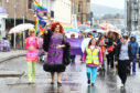 Dahlia Black and Crystal lead the pride parade along the esplanade in Oban.  Picture: Kevin McGlynn