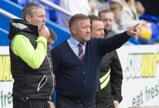 Caley Thistle manager John Robertson with Barry Wilson (left) and Scott Kellacher.