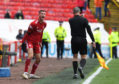 Aberdeen's Dom Ball berates the linesman.