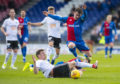 Inverness' Aaron Doran and Ayr's Aaron Muirhead in action