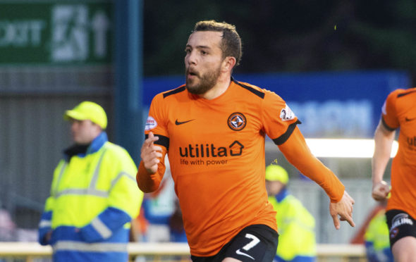 Paul McMullan wheels away in delight after making it 1-0 to Dundee United.