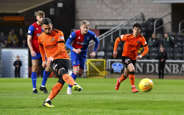 Dundee Utd's Nicky Clark makes it 1-0 from the penalty spot.