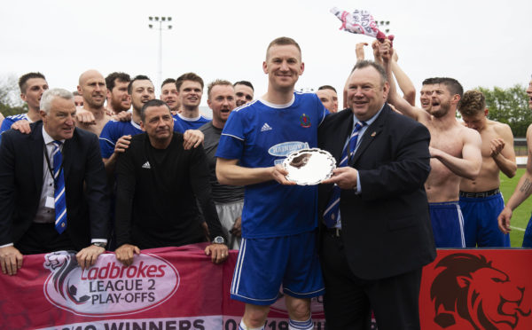 Cove Rangers chairman Keith Moorhouse presents Eric Watson with a commemorative shield on his final appearance for the club.