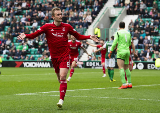 James Wilson celebrates putting Aberdeen 2-1 up.