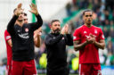 Aberdeen manager Derek McInnes applauds the club's supporters with his players on Sunday.