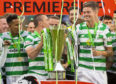 Celtic's Scott Brown (left) and Mikael Lustig lift the Ladbrokes Premiership trophy.