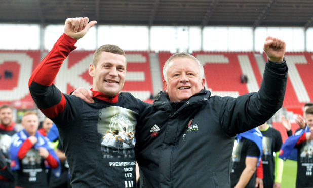 Sheffield United's Paul Coutts (left) and manager Chris Wilder celebrate promotion to the Premier League.