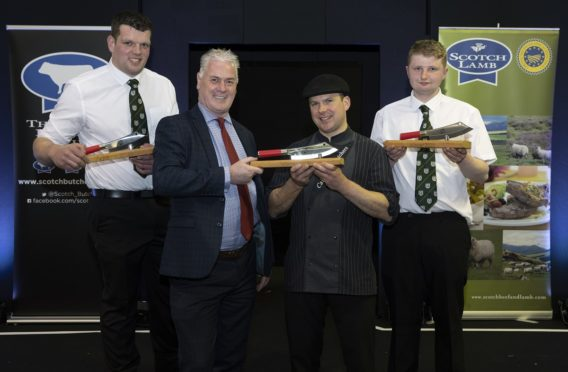 Alan Clarke (left) CEO of Quality Meat Scotland who sponsored the event presenting the Butchers Wars Singles Winner Barry Green from Cairngorm Butchers in Grantown On Spey with his trophy and Butchers Wars Pairs Winners Steven Cusack (left) and Hamish Jones (right) form Davidson Speciality Butcher in Inverurie Picture by Graeme Hart, Perthshire Picture Agency.