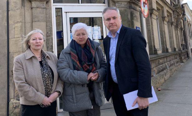 Councillor Theresa Coull, Carol Anderson of TSB & Richard Lochhead MSP outside Keith TSB